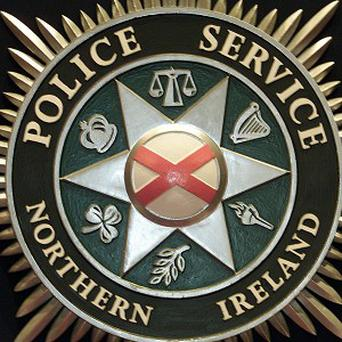 A crowd of up to 100 people attacked police with bricks and bottles at the Carnmoney Road area of Newtownabbey