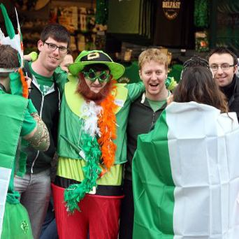 People enjoy the St Patrick's day parade through Belfast city centre