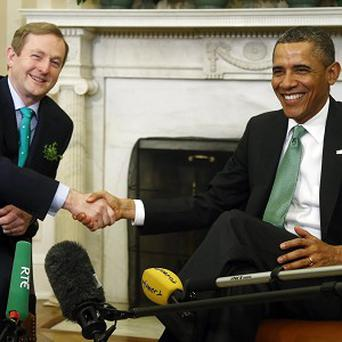 President Barack Obama (right) meets Taoiseach Enda Kenny in the Oval Office (AP)