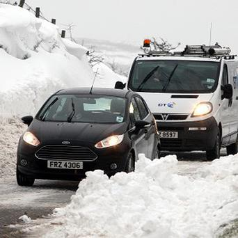 Motorists make their way through snow-covered roads, on the Carnlough to Ballymena road in Co Antrim