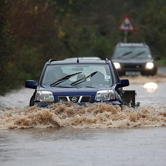 Motorists have been urged to take care after heavy rains caused flash flooding