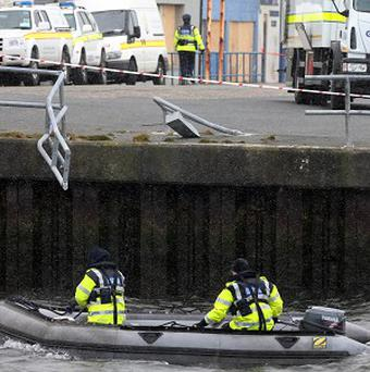 Emergency services search the area around Arklow Pier in Co Wicklow after a car containing a man and a woman plunged into the sea (PA)