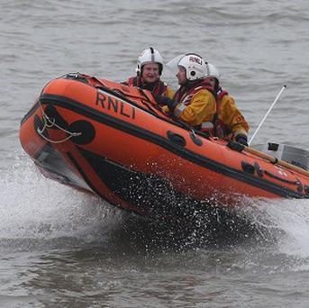 RNLI lifeboats from Dun Laoghaire helped to rescue a swimmer in Dublin Bay, but he later died