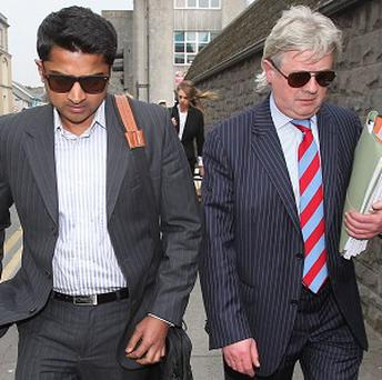 Praveen Halappanavar, the husband of Savita Halappanavar, and his solicitor Gerard O'Donnell leave the inquest into her death