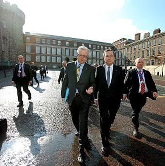 EU Economics Commissioner Olli Rehn and and Mario Draghi, European Central Bank President on their way to Dublin Castle