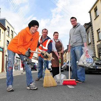 People keeping the streets of Galway tidy as Irish Business Against Litter announced its Litter League for 2013 (Cullen Communications/PA)