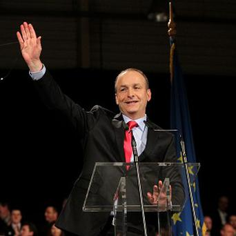 Fianna Fail Leader Micheal Martin addresses party members as their ard fheis opens at the RDS in Dublin