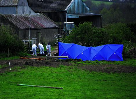 Garda Forensics examining the slurry tank where the body of Bobby Ryan was discovered at the back of farm in Fawnagown outside Tipperary town. Picture Credit: Brian Gavin Press 22