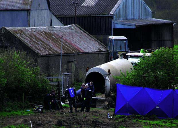 Story by Barry Duggan 02-05-2013 Garda Forensics examining the slurry tank where the body of Bobby Ryan was discovered at the back of farm in Fawnagown outside Tipperary town. Picture Credit: Brian Gavin Press 22