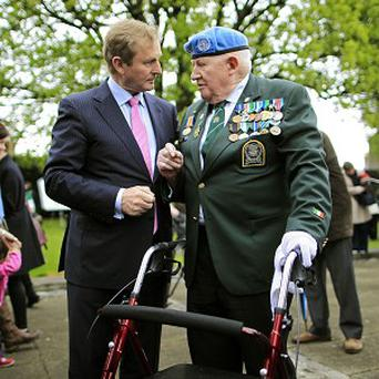 Ray Tumulty, a UN veteran from the Irish Defence Forces, chats to Taoiseach Enda Kenny
