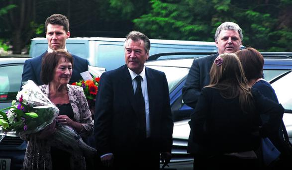 John Cooper (centre) at the funeral of his brother Peter Cooper
