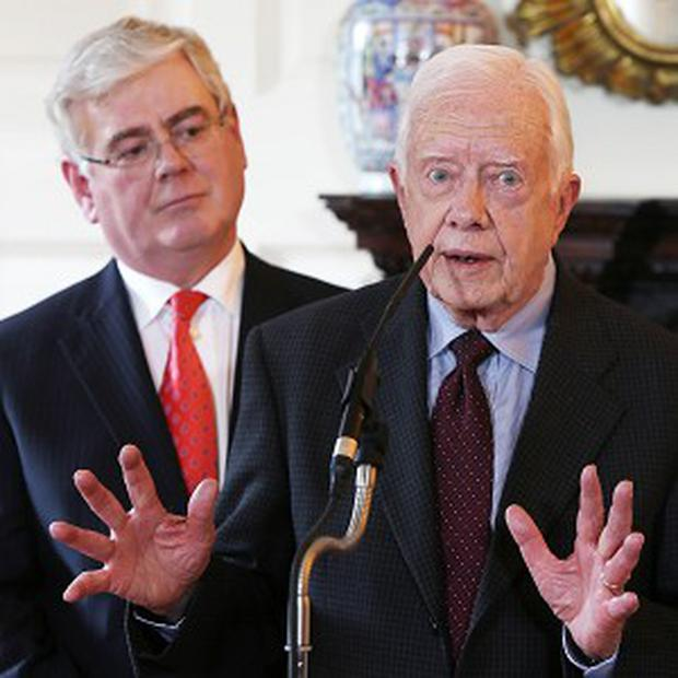 Eamon Gilmore with former US president Jimmy Carter at a press conference in Iveagh House, Dublin