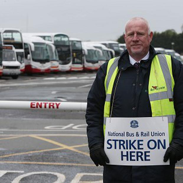 Bus Eireann driver Sean Thunder takes part in a picket at Broadstone Bus Depot