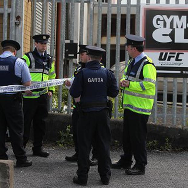 Gardai at the scene where a man was shot at the Ultimate Warrior Gym in Finglas, Dublin