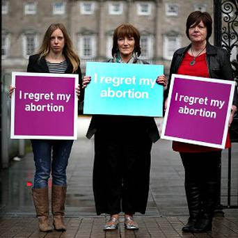 Adele Best, Bernadette Goulding and Lynn Coles from the campaign group Women Hurt at Leinster House in Dublin