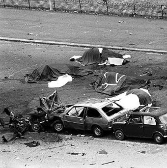 Dead horses lie covered in the aftermath of the car bomb blast near Hyde Park