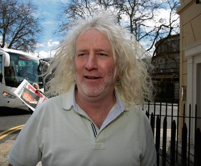 Mick Wallace: sued after wrongful arrest