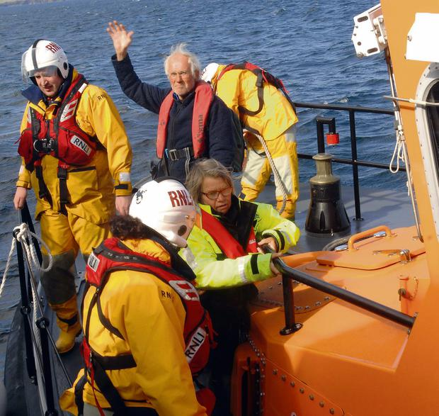 Gretta and Erik Ostberg, owners of the Norwegian yacht 'Alice 2', on a RNLI Lifeboat arriving at Castletownbere Harbour, West Cork