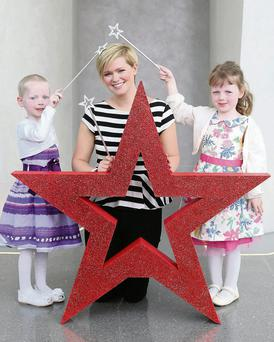 Leukaemia patient Olivia Killian (4) and her twin, Laura, join author Cecelia Ahern at launch of Barretstown campaign last year