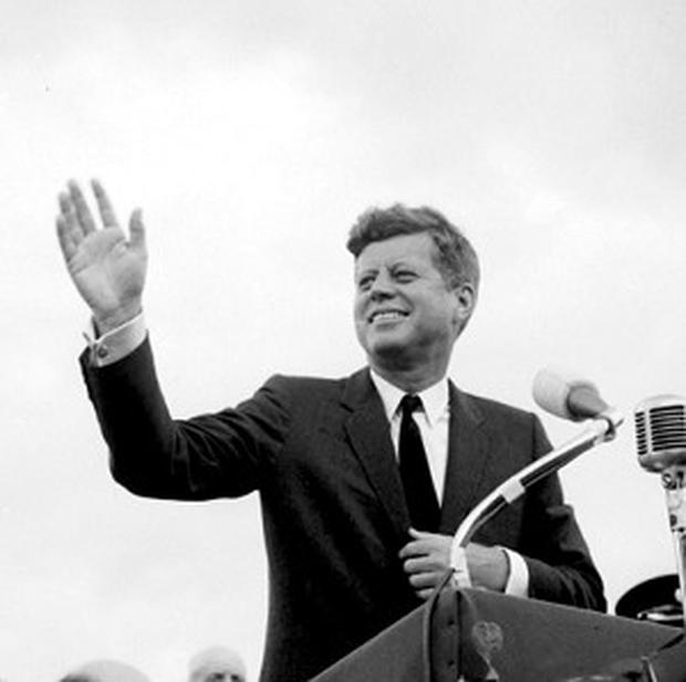 President John F Kennedy acknowledges the cheers of the crowd in New Ross, Co Wexford, during his 1963 visit to Ireland