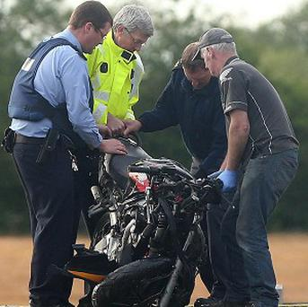 A motorcycle is loaded onto a lorry on the N78 close to Athy, Co Kildare after a collision in which three people died