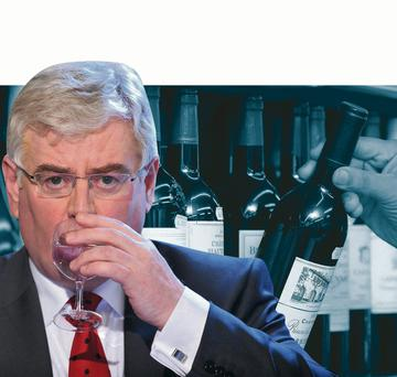 Tanaiste and Foreign Affairs Minister Eamon Gilmore sipping water from a wine glass as it is revealed that his department is to sell off its more expensive wines