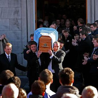 Mourners attend the funeral of Shane Geoghegan, who was gunned down outside his home in Limerick in 2008
