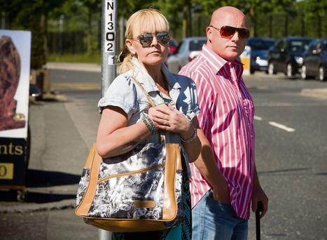 Audrey Fitzpatrick, mother of Dean Fitzpatrick, and her partner Dave Mahon, who has admitted inflicting the fatal stab wound, wait for a taxi near his apartment in Dublin yesterday afternoon
