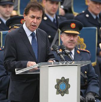 Justice Minister Alan Shatter, left, said action is being taken to address concerns at Cork prison