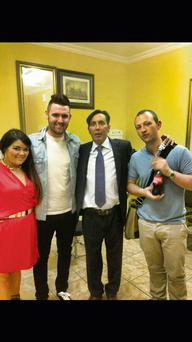 Christy Dignam (second from right) pictured with his daughter Kiera, left, and her fiance Darren Moran (right) at the charity night in Citywest, Dublin