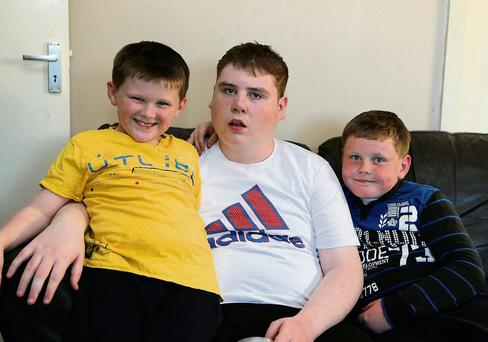Jason Nagle (centre) with his brothers Chris (left) and Michael.