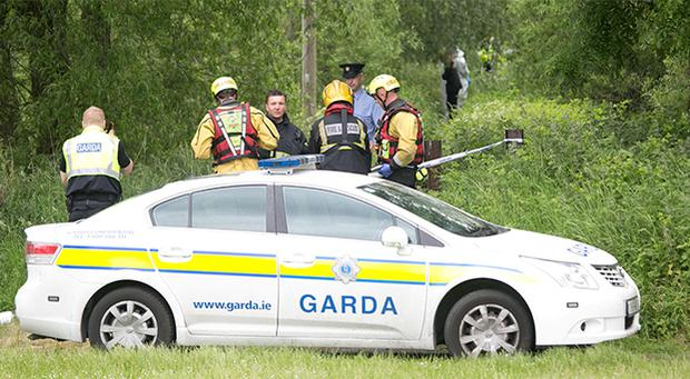 Gardai and Emergency services at the scene where the body of a teenage girl was discovered at Kileely, Limerick.