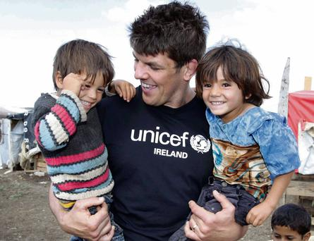 NO REPRO FEE released 10/6/2013 UNICEF Ireland Humanitarian Mission to Lebanon. Irish rugby star and UNICEF Ireland Ambassador Donncha O'Callaghan has returned home from a humanitarian mission to Lebanon with UNICEF Ireland where he saw first-hand the dire situation for Syrian children and their families. The crisis that has left more than 70,000 people dead and nearly six million displaced from their homes. Accompanied by UNICEF staff and UNICEF Ireland Executive Director Peter Power, Donncha visited makeshift settlements in the Bekaa region of Lebanon, the country that hosts the largest number of Syrian refugees in the world. He also visited various locations in the region that provide psychosocial activities and mobile schools for children and teenagers affected by the conflict. Donncha is pictured with siblings, four-year-old Mohmoud and five-year-old Kawthar in a tented settlement at border area in Akkar. The number of those arriving from Syria is growing dramatically, with more than 100,000 crossing the border each month. The resources of Lebanese host communities, the Government, and humanitarian organisations are being stretched to the limit. To donate please visit www.UNICEF.ie or call 1850 767 999. Photo: Mark Stedman/Photocall Ireland