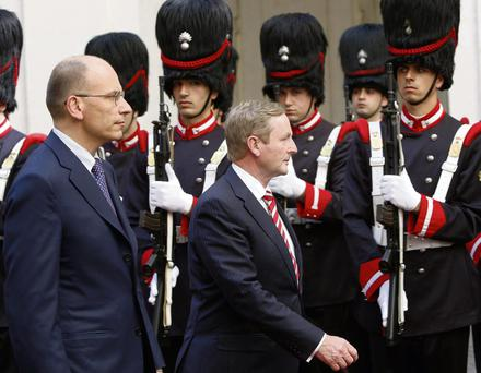 Enda Kenny with Italy's new prime minister Enrico Letta, left, inspects the guard of honour in Rome
