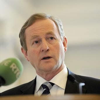Taoiseach Enda Kenny has been branded a murderer over plans to reform laws on abortion