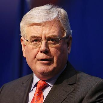 Tanaiste Eamon Gilmore has been urged to condemn the Catholic Church for not criticising anti-abortion campaigners who attack politicians