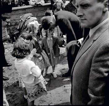 JFK bends down to talk to six-year-old Kathleen Doyle (JFK Library)