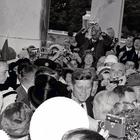 JFK struggles to stay upright as party guests surge around him. Inset: An invite for the party