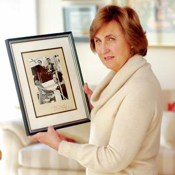 Harpist Ruth Hurson with her photograph from the day signed by JFK