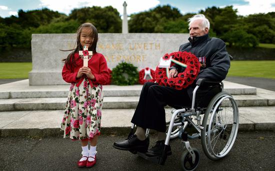 Zowie Brown, aged six, whose great grandfather was a pardoned Irish soldier at the Irish National Irish War Memorial in Islandbridge, Dublin, with World War Two veteran and pardoned former Irish soldier 92 year-old Phillip Farrington during a wreath laying ceremony to mark the passing recently of the Amnesty and Immunity Bill.