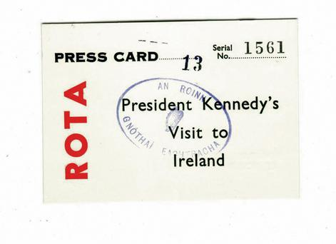 An official press card for the visit