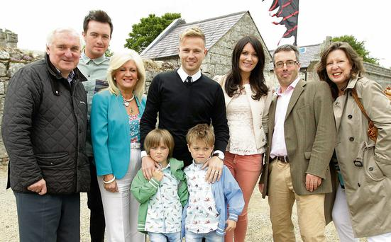 Pictured in Carlow for a talk on the Byrne family's roots were, from left, former Taoiseach Bertie Ahern, Adam McGarry, Yvonne Byrne, Nicky Byrne with twins Rocco and Jake, Nicky's wife Georgina, Turtle Bunbury and Lady Kilbracken
