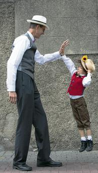 Hal Ledford from Dalkey, Jonathan Aguiard (7) from Monkstown during a world record attempt for the largest gathering of James Joyces lookalikes in one location as part of Bloomsday celebrations at Dunphy's Pub, Dun Laoghaire, Dublin