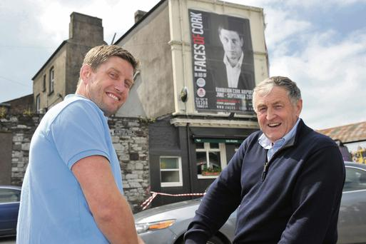 Ronan O'Gara with exhibition organiser Dennis Horgan in front of the rugby star's portrait hung on the walls of 'The Sextant' pub in Cork city.
