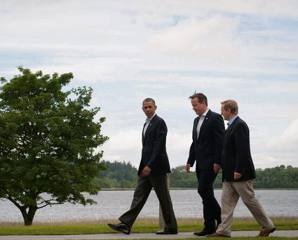 British Prime Minister David Cameron walks to lunch with US President Barack Obama and Taoiseach Enda Kenny