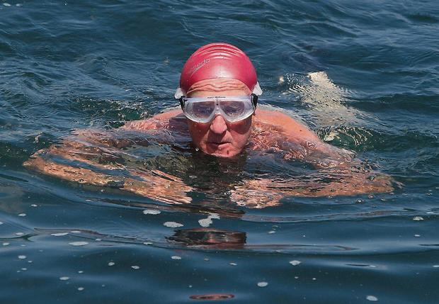 'Father Ted' actor Frank Kelly swims at the Forty Foot
