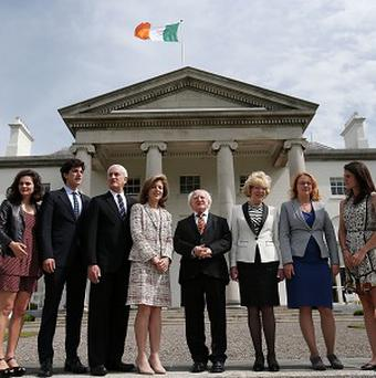 President of Ireland Michael D Higgins chats with Caroline Kennedy, centre, and others at Aras an Uachtarain, his official residence in Dublin