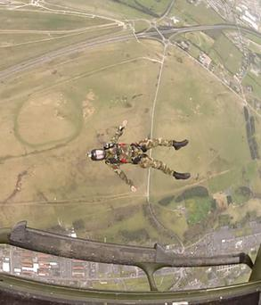 AN Army parachutist falls away from an Air Corps helicopter over the Curragh, Co Kildare.