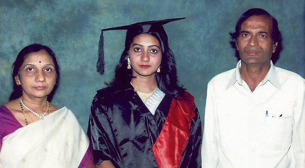 Savita with her parents on the day she graduated as a dentist in Belgaum, India.