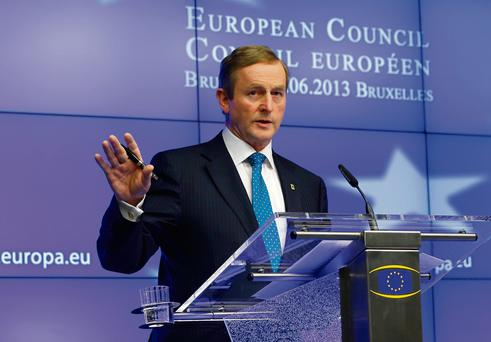 Enda Kenny addresses a news conference at the end of the EU summit in Brussels.